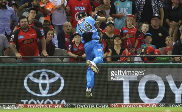 Adelaide Strikers Ben Laughlin takes a catch which he then threw to Jake Weatherald to dismiss Renegades Dwayne Bravo during the Big Bash League...