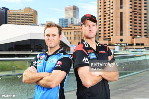Adelaide Strikers captain Colin Ingram and Melbourne Renegades captain Cameron White pose on the Adelaide Footbridge during the Big Bash League Semi...