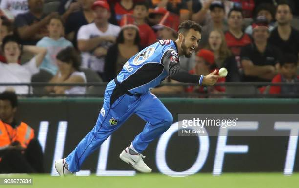 Adelaide Strikers Jake Weatherald takes a catch thrown to him by Ben Laughlin to dismiss Renegades Dwayne Bravo during the Big Bash League match...
