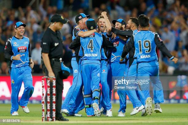 Adelaide Strikers players celebrate winning the Big Bash League match between the Adelaide Strikers and the Melbourne Renegades at Adelaide Oval on...