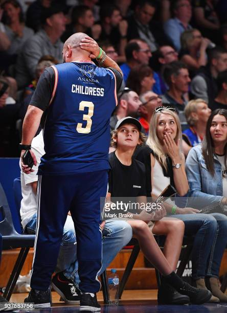 Adelaide supporter who was taken out by Mitch Creek of the Adelaide 36ers while sitting in the crowd rubs his head during game four of the NBL Grand...