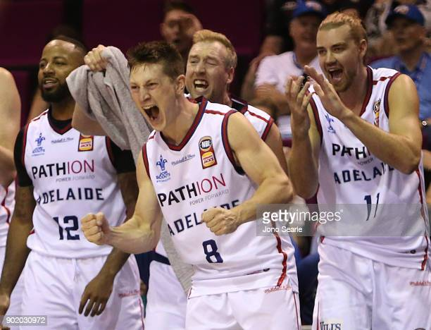 Adelaide team mates celebrate on the bench during the round 13 NBL match between the Brisbane Bullets and the Adelaide 36ers at Brisbane Convention...