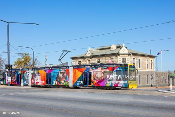 adelaide tram adorned with street art images advertising the sala festival, passing historic hotel - adelaide festival stock pictures, royalty-free photos & images