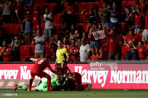 Adelaide United celebrate their winning goal during the round 17 ALeague match between Adelaide United and the Brisbane Roar at Coopers Stadium on...