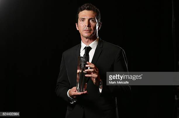 Adelaide United coach Guillermo Amor poses with the Hyundai ALeague Coach of the Year Award during the 2016 FFA Dolan Warren Awards at Carriageworks...