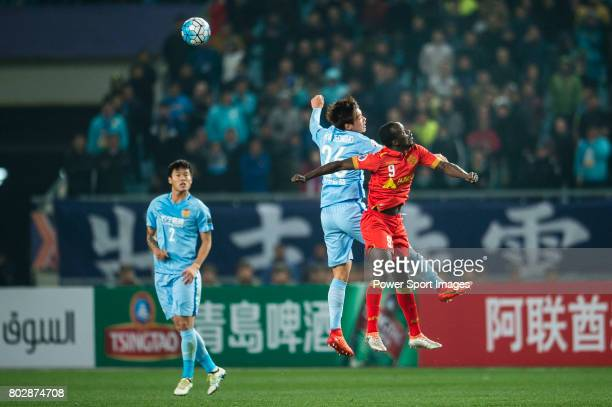Adelaide United Forward Papa Babacar Diawara fights for the ball with Jiangsu FC Defender Hong Jeongho during the AFC Champions League 2017 Group H...