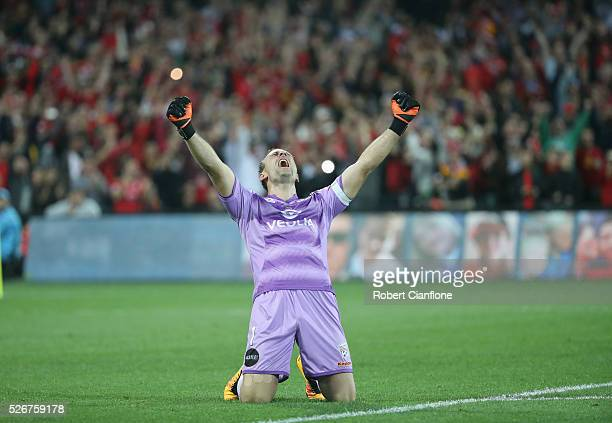 Adelaide United goalkeeper Eugene Galekovic celebrates after United defeated the Wanderers during the 2015/16 A-League Grand Final match between...