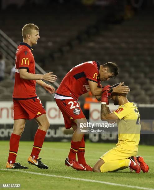 Adelaide United goalkeeper Paul Izzo celebrates with team mates after Adelaide United defeated the Victory during the round 10 ALeague match between...