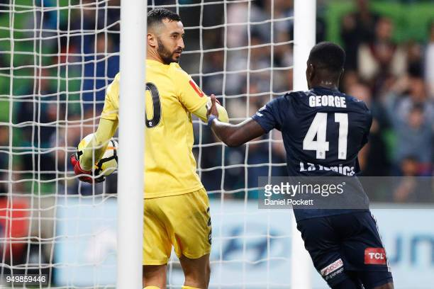 Adelaide United goalkeeper Paul Izzo holds the ball after Leroy George of the Victory scored a goal during the ALeague Elimination Final match...