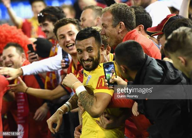 Adelaide United goalkeeper Paul Izzo is congratulated by fans during the round 10 ALeague match between the Melbourne Victory and Adelaide United at...