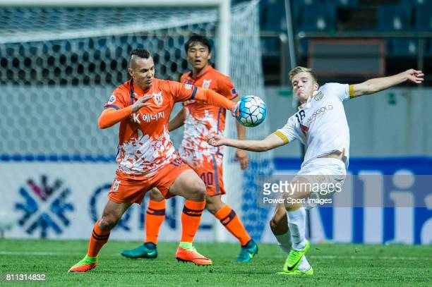 Adelaide United Midfielder Riley Patrick Mcgree fights for the ball with Jeju United Forward Marcelo Toscano during the AFC Champions League 2017...