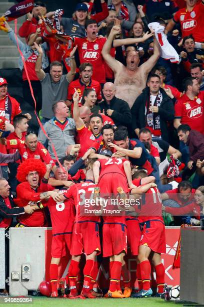Adelaide United players and fans celebrate a goal during the ALeague Elimination Final match between Melbourne Victory and Adelaide United at AAMI...