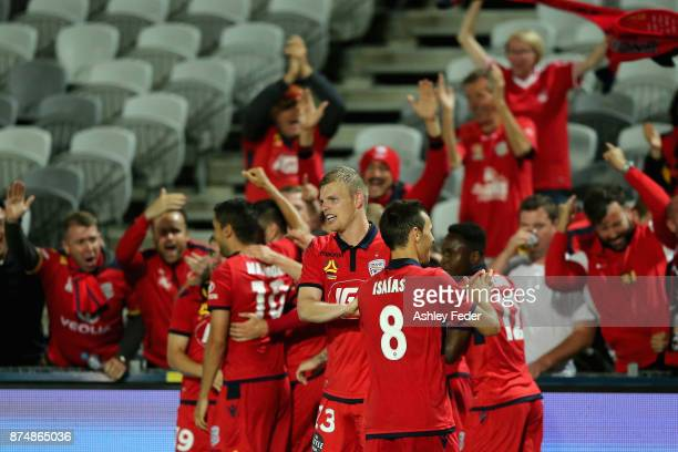 Adelaide United players and fans celebrate a goal from Ryan Kitto during the round seven ALeague match between the Central Coast Mariners and...