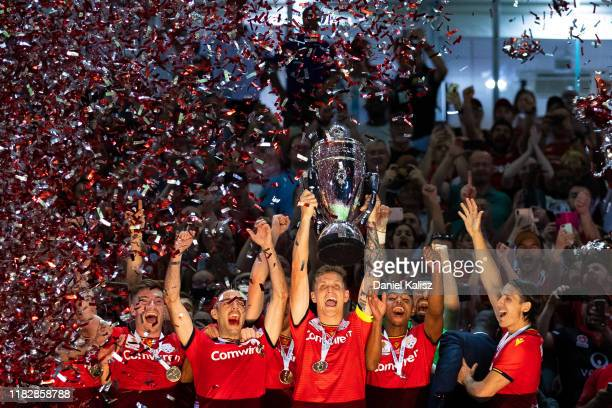 Adelaide United players celebrate with the trophy after defeating Melbourne City during the FFA Cup Final between Adelaide United and Melbourne City...