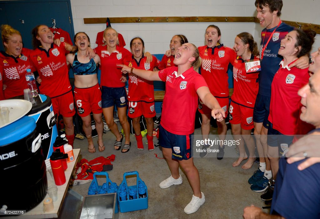 Adelaide United players sing the team song after the round three W-League match between Adelaide United and the Perth Glory at Marden Sports Complex on November 10, 2017 in Adelaide, Australia.