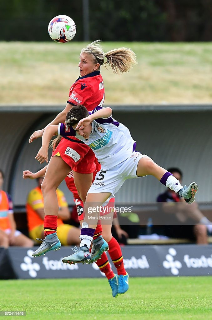 Adelaide United's Alyssa Mautz heads over the top of Perth's Patricia Charalambous during the round three W-League match between Adelaide United and the Perth Glory at Marden Sports Complex on November 10, 2017 in Adelaide, Australia.