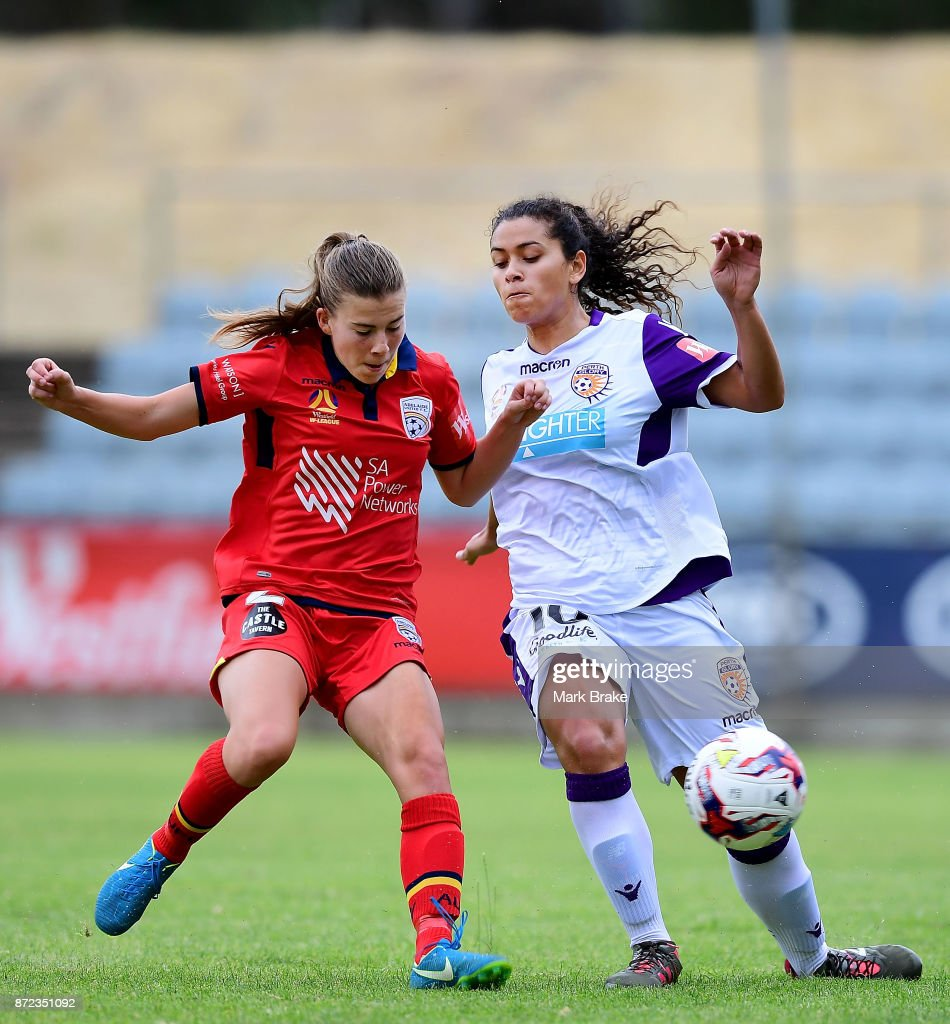 Adelaide United's Emily Hodgson competes with Perth's Raquel Rodriguez during the round three W-League match between Adelaide United and the Perth Glory at Marden Sports Complex on November 10, 2017 in Adelaide, Australia.
