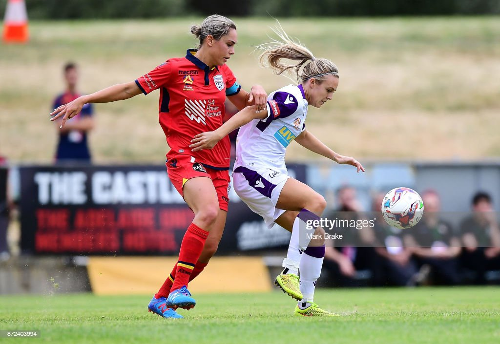 Adelaide UNited's Emma Checker competes with Perth's Patricia Charalambous during the round three W-League match between Adelaide United and the Perth Glory at Marden Sports Complex on November 10, 2017 in Adelaide, Australia.