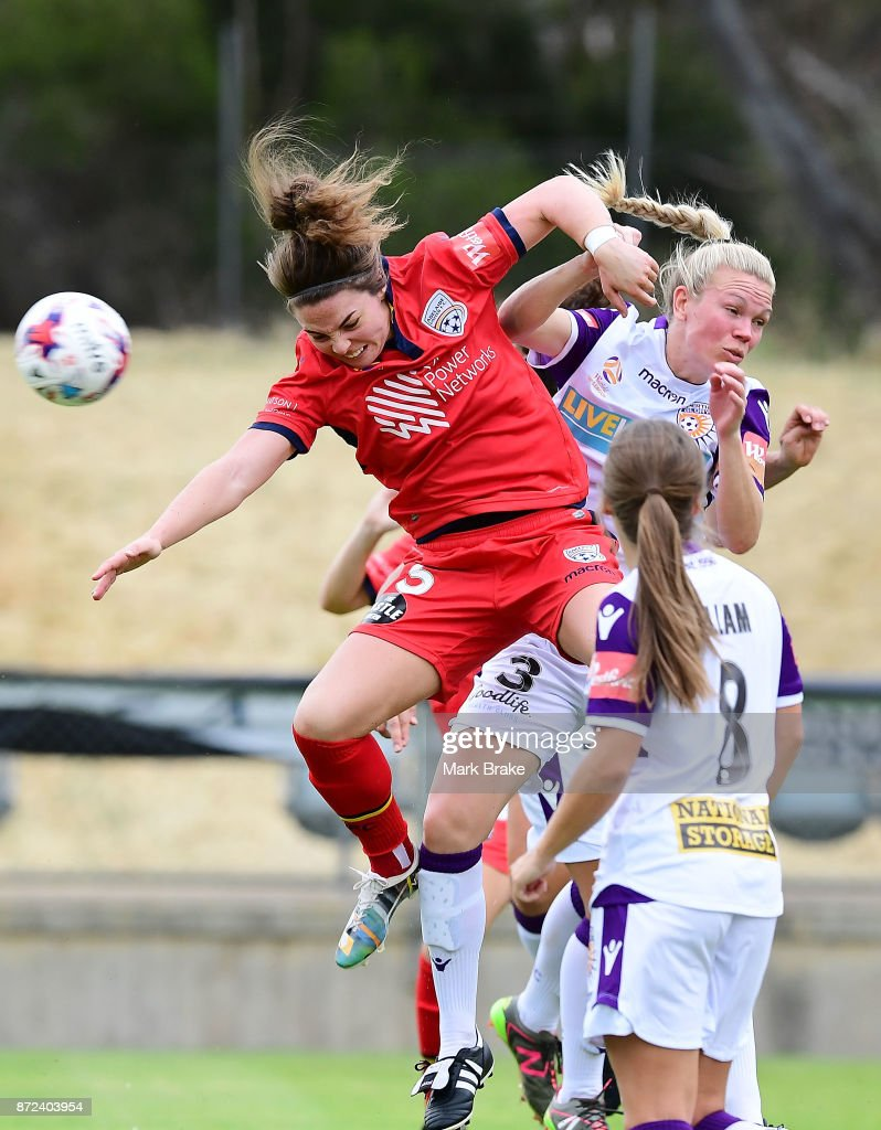 Adelaide United's Jenna McCormick competes against Perth's Kim Carroll during the round three W-League match between Adelaide United and the Perth Glory at Marden Sports Complex on November 10, 2017 in Adelaide, Australia.