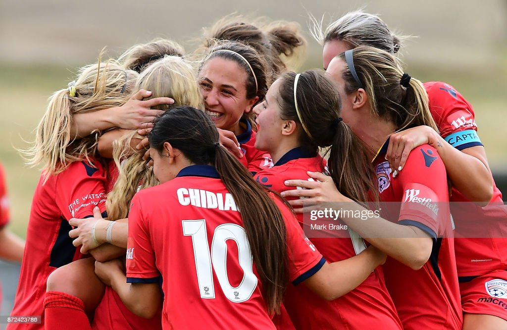 Adelaide United's Makenzy Doniak scores her hatrick and is hugged by team mates during the round three W-League match between Adelaide United and the Perth Glory at Marden Sports Complex on November 10, 2017 in Adelaide, Australia.