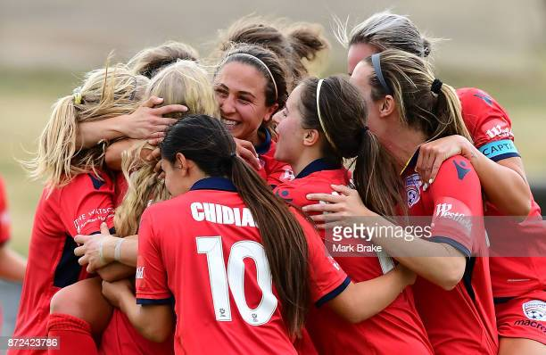 Adelaide United's Makenzy Doniak scores her hatrick and is hugged by team mates during the round three WLeague match between Adelaide United and the...