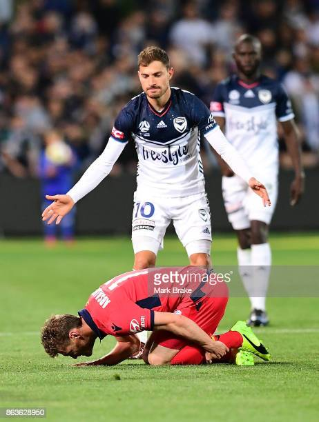 Adelaide's Johan Absalonsen is tackled by Melbourne's James Troisi resulting in a yellow card during the round three ALeague match between Adelaide...