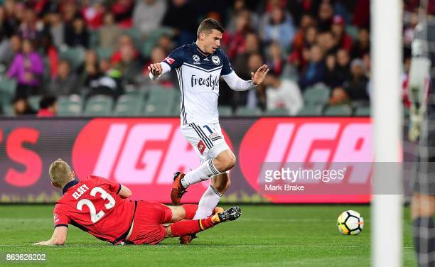 Adelaide's Jordan Elsey tackles Melbourne's MItchell Austin during the round three ALeague match between Adelaide United and Melbourne Victory at...