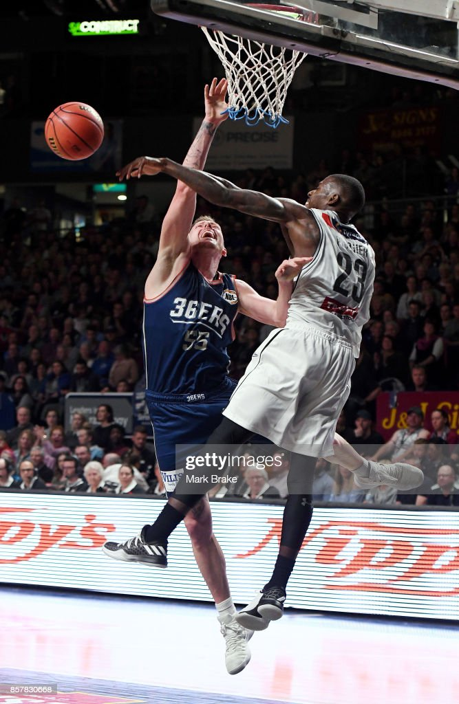 Adelaides Mitch Creek gets a shot rejected by Melbournes Casey Prather during the round one NBL match between the Adelaide 36ers and Melbourne UInited at Titanium Security Arena on October 5, 2017 in Adelaide, Australia.
