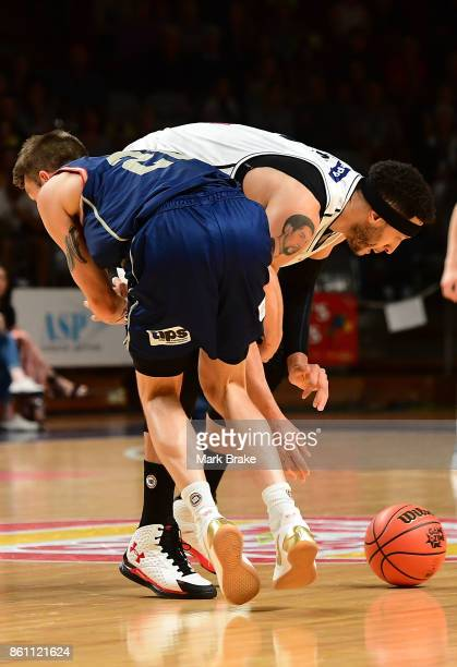 Adelaide's Nathan Sobey runs into Melbourne's Kyle Adnam during the round two NBL match between the Adelaide 36ers and Melbourne United at Titanium...