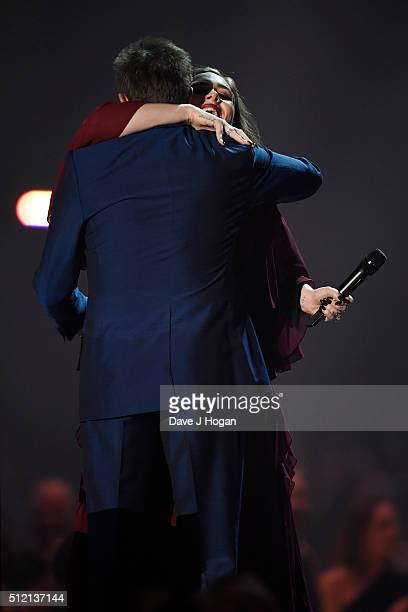 Adele accepts an award from Simon Le Bon at the BRIT Awards 2016 at The O2 Arena on February 24 2016 in London England
