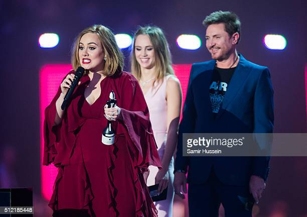 Adele accepts her British Single from Suki Waterhouse and Simon Le Bon at the BRIT Awards 2016 at The O2 Arena on February 24 2016 in London England