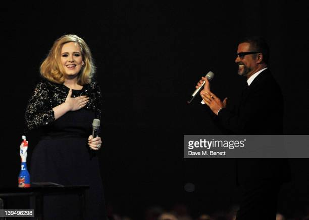 Adele accepts the Best Album award from George Michael during the BRIT Awards 2012 held at the O2 Arena on February 21 2012 in London England