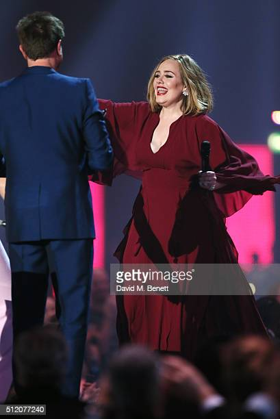 Adele accepts the British Single award for Hello from Simon Le Bon at the BRIT Awards 2016 at The O2 Arena on February 24 2016 in London England