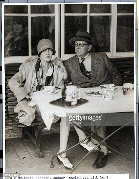 Adele Astaire dancer having tea with Lord Portarlington at Le Touquet Airpost France