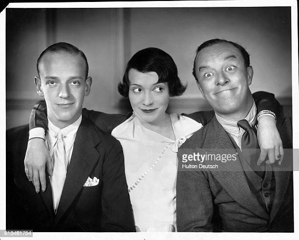 Adele Astaire stands in the middle of Fred Astaire and Leslie Hanson in the play Funny Face
