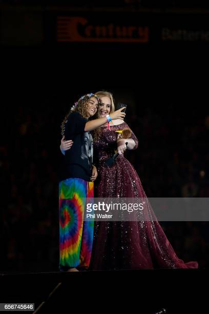 Adele brings a fan onto the stage as she performs at Mt Smart Stadium on March 23, 2017 in Auckland, New Zealand.