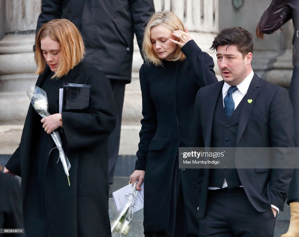 Adele, Carey Mulligan and Marcus Mumford attend the Grenfell Tower national memorial service at St Paul's Cathedral on December 14, 2017 in London, England. The multi-faith memorial service attended by The Prime Minister and members of The Royal Family marks the six month anniversary of the Grenfell Tower fire in which 71 people died.