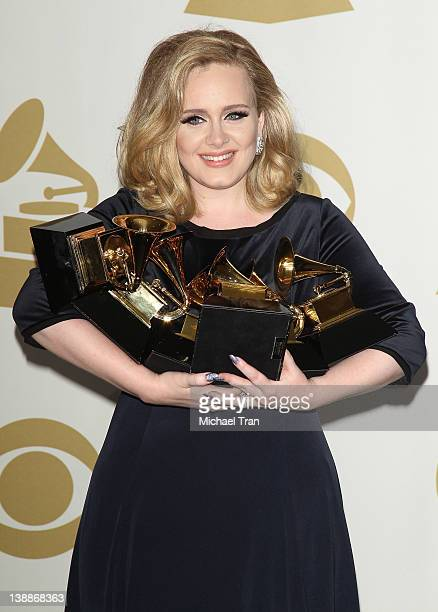 Adele holds her 6 GRAMMYS at the 54th Annual GRAMMY Awards press room held at Staples Center on February 12 2012 in Los Angeles California