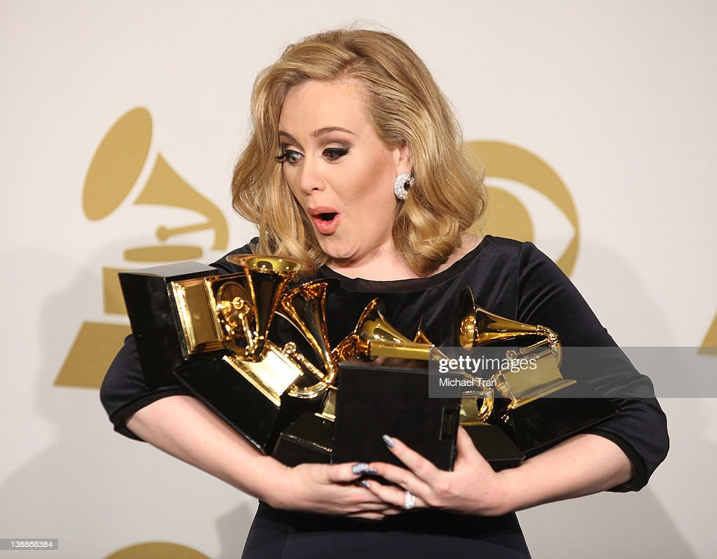 Adele holds her 6 GRAMMYS at the 54th Annual GRAMMY Awards - press room  held at