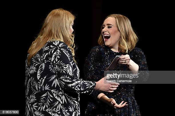 Adele jokes with a fan at Genting Arena on March 29 2016 in Birmingham England