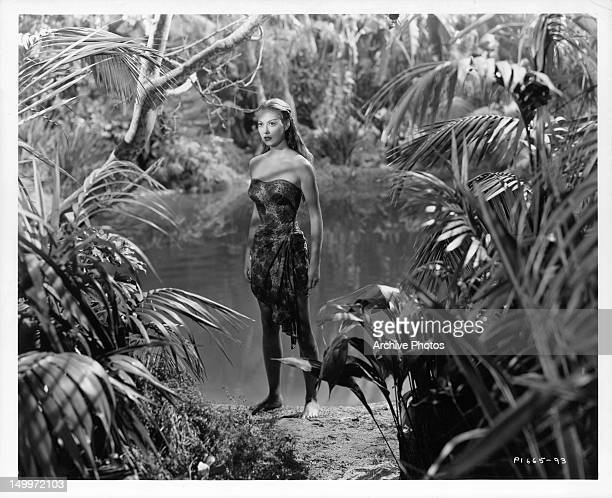 Adele Mara walking in the jungle in a scene from the film 'Wake Of The Red Witch' 1948