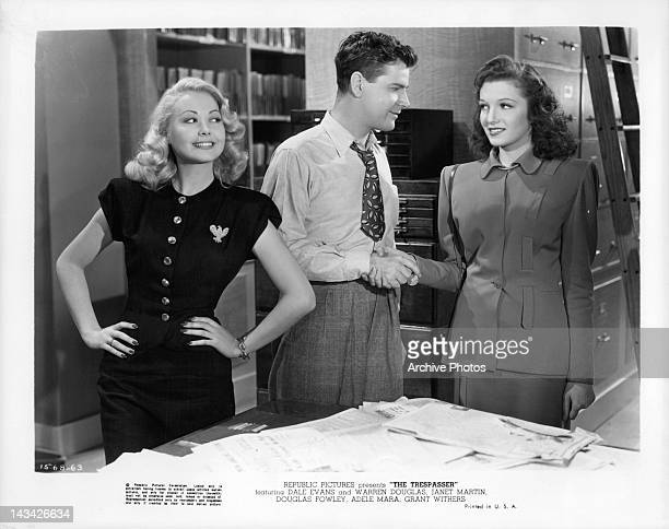 Adele Mara with hands to her hips as Grant Withers shakes hand of Janet Martin in a scene from the film 'The Trespasser' 1947