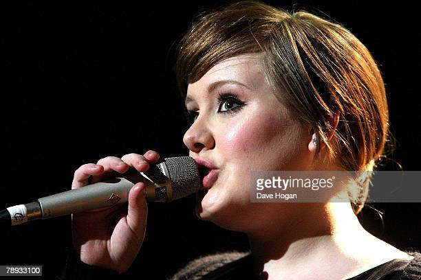 Adele performs on stage at the BRITs Nominations Launch Party at the Roundhouse Camden on January 14 2008 in London England