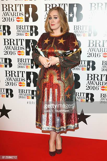 Adele poses in the winners room at the BRIT Awards 2016 with her 4 Brit awards at The O2 Arena on February 24 2016 in London England
