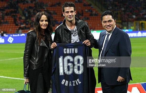 Adelina Chivu, Cristian Chivu and FC Internazionale Milano President Eric Thohir pose with Cristian Chivu's celebratory shirt after confirming his...