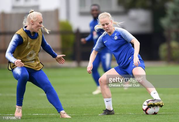 Adelina Engman of Chelsea is challenged by Maria Thorisdottir of Chelsea during a training session at Chelsea Training Ground on March 20 2019 in...