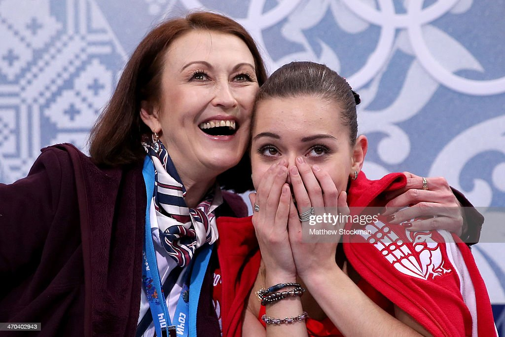 Adelina Sotnikova (R) of Russia celebrates her score with her coach in the Figure Skating Ladies' Short Program on day 12 of the Sochi 2014 Winter Olympics at Iceberg Skating Palace on February 19, 2014 in Sochi, Russia.