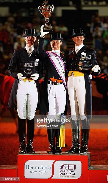 Adelinde Cornelissen of the Netherlands pictured after winning with Nathalie zu SaynWittgenstein of Denmark who came second and Ulla Salzgeber of...