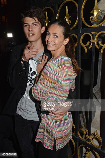 Adeline Blondieau and her son Aitor attend the 'Fifa 15' : Party At L'Opera Restaurant on September 22, 2014 in Paris, France.
