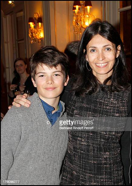 Adeline Blondieau and son Aitor at The Hotel Plaza Athenee Cocktail Party In Conjunction With Bertrand De Saint Vincent's Book Signing Of Tout Paris .
